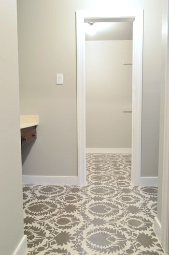 stenciled sub-floor, perfect for a laundry room floor!!