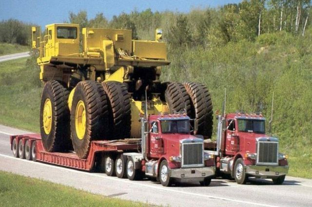 saw this being used on I77 & I85 connection near Charlotte NC - it had a dump bed on it = so glad to see this photo = wondered how they moved it = amazing