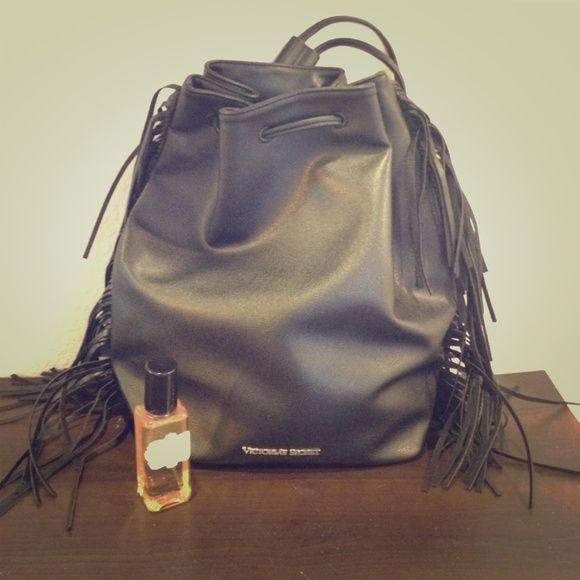 Victoria secret bundle!! Backpack and perfume. Victoria secret backpack and NIOR body spray bundle! Black leather backpack from runway show. Fronde down the sides and drawstring opening. Victoria's Secret Bags Backpacks