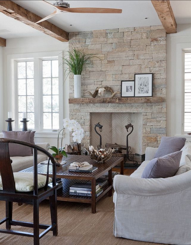"""Wettling Architects. The stone is """"South Bay quartzite"""". The stone is 84″ wide. The opening is 48″ wide.  This is a rumford fireplace."""