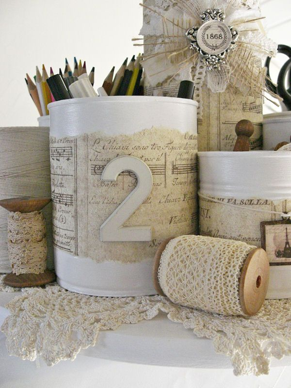 Shabby Chic Inspired: Tin-Can Caddy >> You could decorate the cans in all different ways. Even have your kids/students decorate them for their rooms.