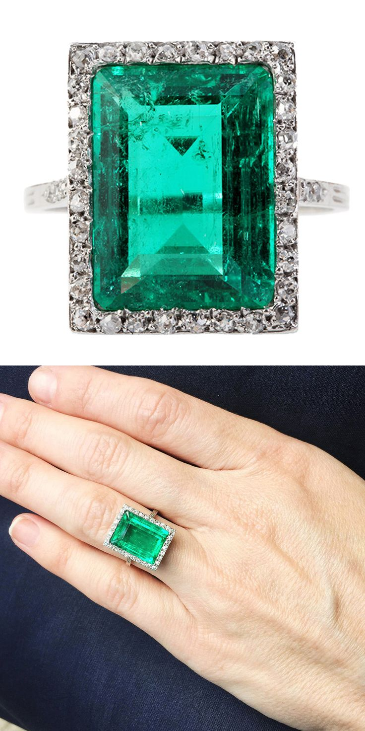 Edwardian Emerald Diamond Platinum Ring. 4.7 carats surrounded by pave set single cut stones. Circa 1910. Emerald is certified as Colombian with minor oil treatment. United Kingdom
