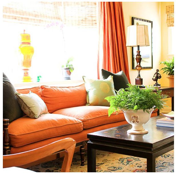 lots of faves--orange sofa, tortoise blinds, black accent tables, danish modern wood piece!