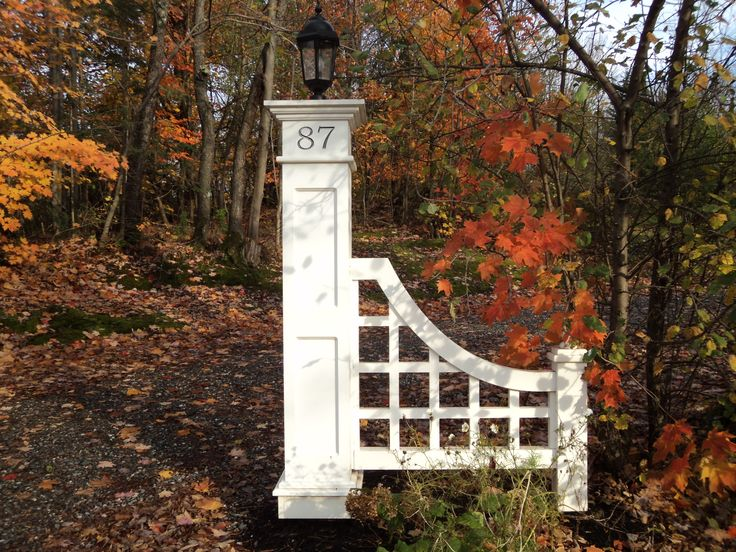 Elegant column with side fence used to define driveway entrance. See more at miss-cupola.com