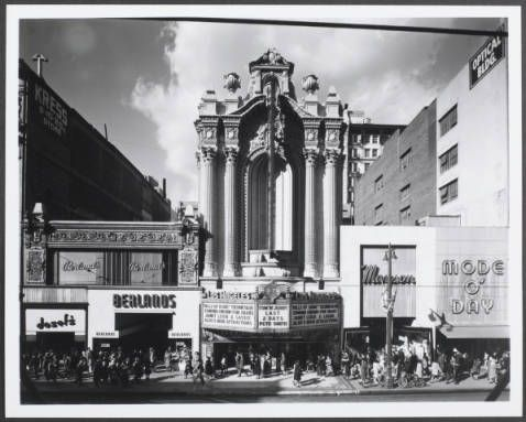 """In Downtown Los Angeles, frontal view of the Los Angeles theatre showing Doself's and Berland's stores at left and Mode O' Day and Mayson stores at right :: """"Dick"""" Whittington Photography Collection, 1924-1987"""