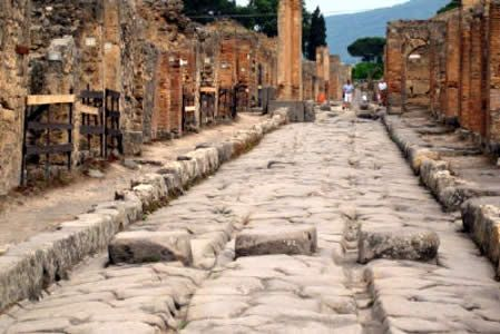 Road in old Pompeii, note the ruts from the chariot wheels.