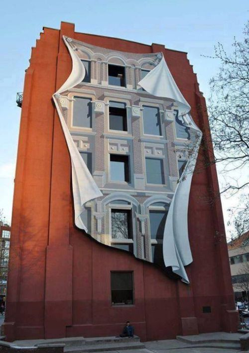 Realistic 3D art illusion on a building. street art graffiti by Patrick Commecy.