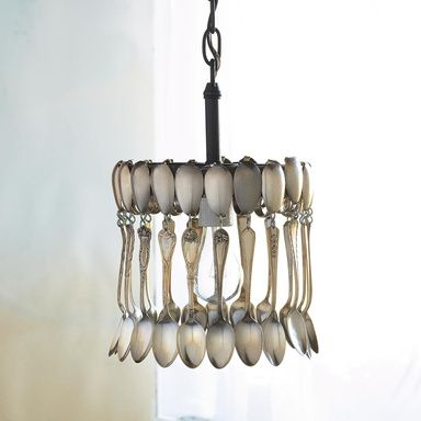 "VINTAGE SPOON CHANDELIER -- Vintage silverplate spoons from the 1920s and beyond serve up inspired illumination. Each chandelier will vary according to the flatware patterns used. Handmade. USA. Black chain. 8""W x 8""D x 13-1/2""H."