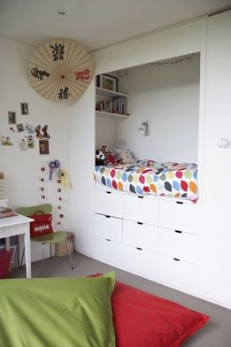 Kid's built-in bed/nook with storage below