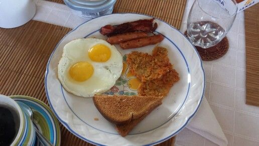 American Brunch, eggs, bacon, sausages, toasts and hash browns