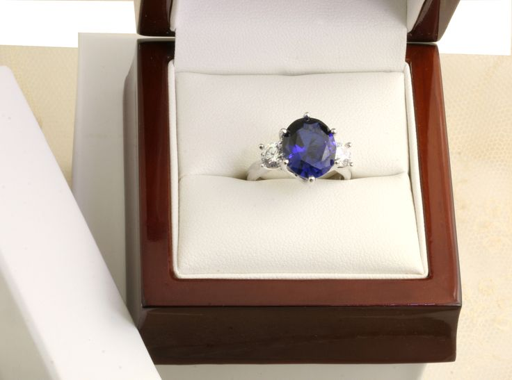 a sensational Sapphire and Diamond three-stone. A beautiful Oval Sapphire in 18ct white gold.