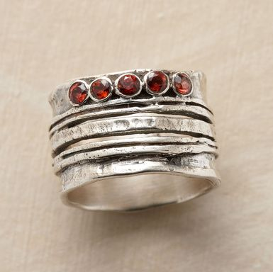 "Cinq Ring  Five garnets sparkle atop five variegated bands of hand-hammered sterling silver, making beautiful harmony. Whole sizes 6 to 10. 1/2""W."