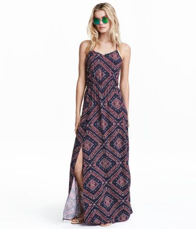 V-neck maxi dress with narrow shoulder straps. Opening with covered button at back of neck, elasticized seam at waist, and high slits at front.