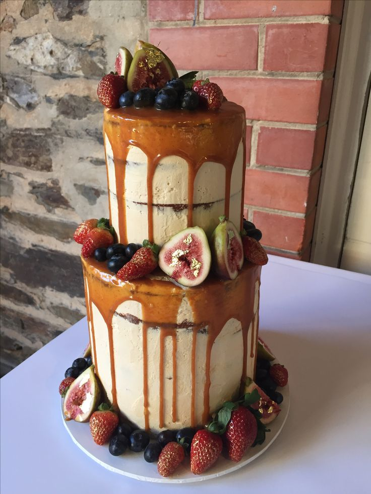 Vanilla cake with salted caramel Swiss meringue buttercream and burnt salted caramel sauce. Fresh fruit and gold leaf?