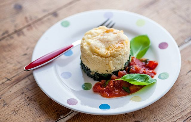 Double baked smoked haddock soufflé with tomato, pepper and olive sauce