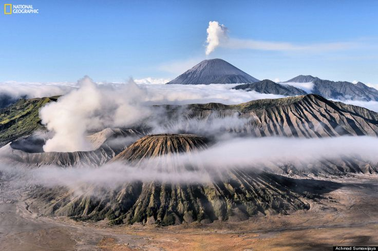 """Misty Morning At Mount Bromo  """"Misty morning at Mount Bromo, Mount Batok and Semeru when I take this picture. I had waited 3 hours to get this moment."""" Location: East Java.  Photo and caption by Achmad Sumawijaya/ National Geographic 2014 Photo Contest."""