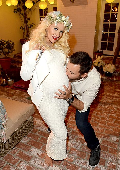 Counting down to baby No. 2! Christina Aguilera, who is expecting a baby girl, was the guest of honor at a baby shower in L.A. She looked angelic in a Lattice maxi dress by Tees by Tina in cream and a flower wreath headband. See her unusual cake!