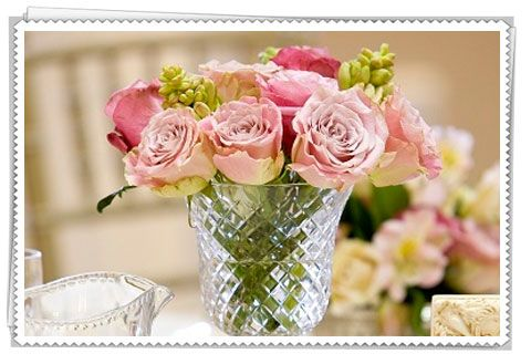 Any glass or silver container for pink roses would be amazing.