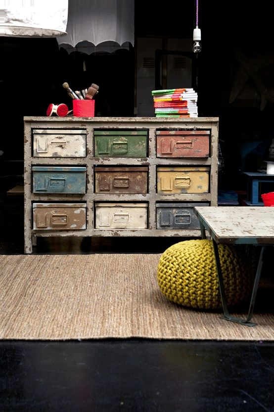 Recycled/Distressed sideboard, knit pouf, hairpin table, Dark walls and floor, natural fiber looking rug... All I love these days!