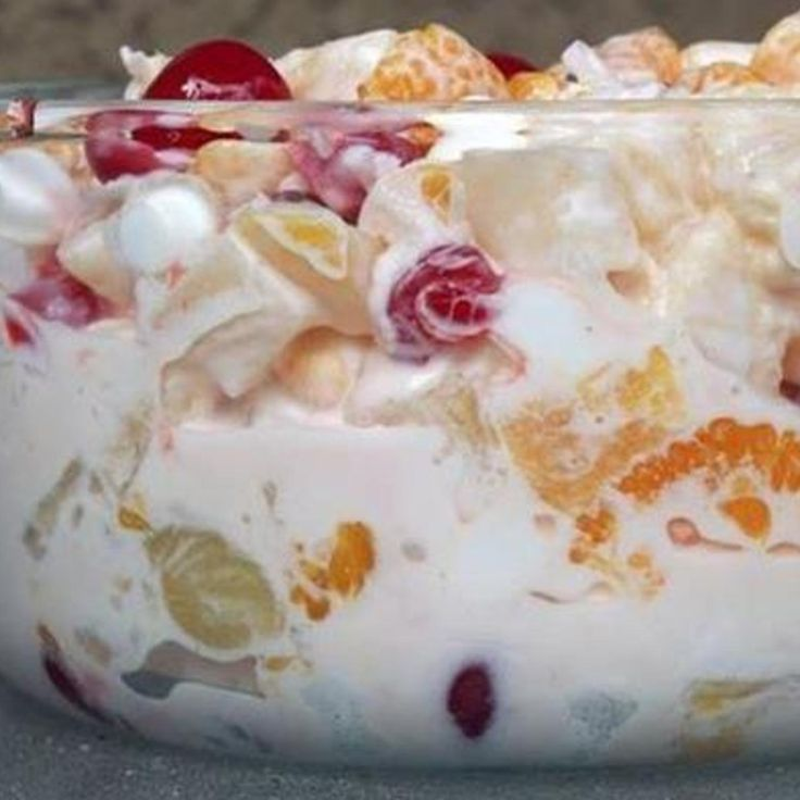 Ambrosia - Gram Isabels fav -  (8 oz) container frozen whipped topping, thawed  2 1/2 c  shredded coconut  1/2 c  chopped walnuts or pecans  1 can(s)  (8 oz) fruit cocktail, drained  1 can(s)  (8 oz) pineapple chunks, drained  1 can(s)  (11 oz) mandarin oranges, drained  3 c  miniature marshmallows  1 jar(s)  (10 oz) maraschino cherries, drained  Mix and refridge for 1 hr b4 serving