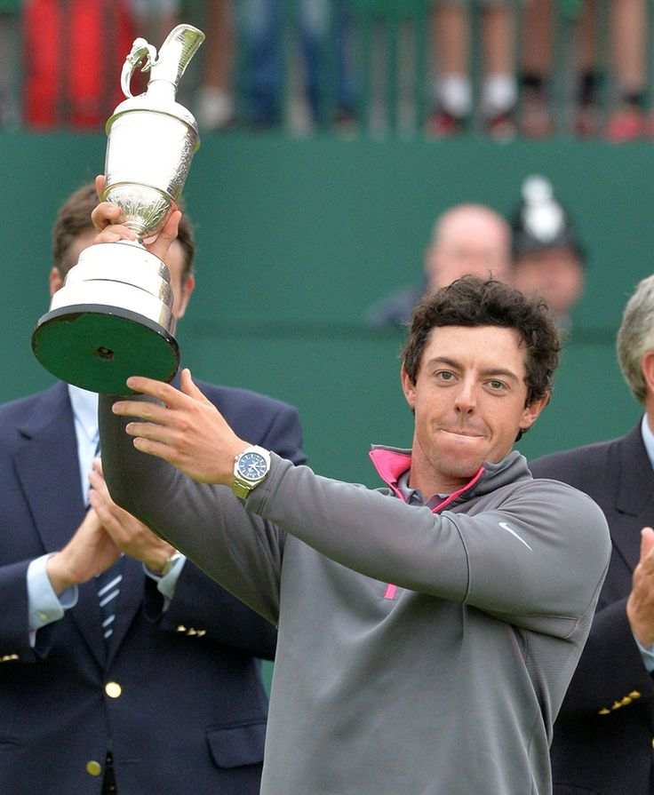 Rory McIlroy holds the Claret Jug