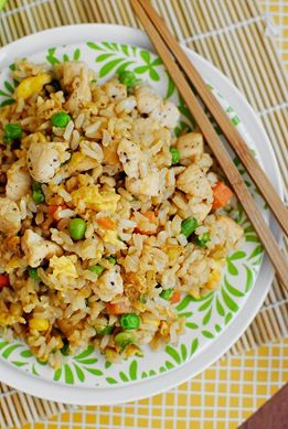 CHICKEN FRIED RICE  2 cups prepared rice (I used long grain brown rice)  1 chicken breast, cut into bite-sized pieces and seasoned with salt & pepper (could use leftover cooked chicken)  1/2 cup frozen mixed vegetables  2 green onions, chopped  1 clove garlic, minced  1 egg  3 teaspoons sesame or wok oil, divided  2 Tablespoons soy sauce