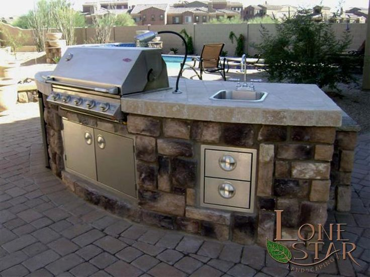 Curved Counter Barbecue With Travertine Tile And Cultured
