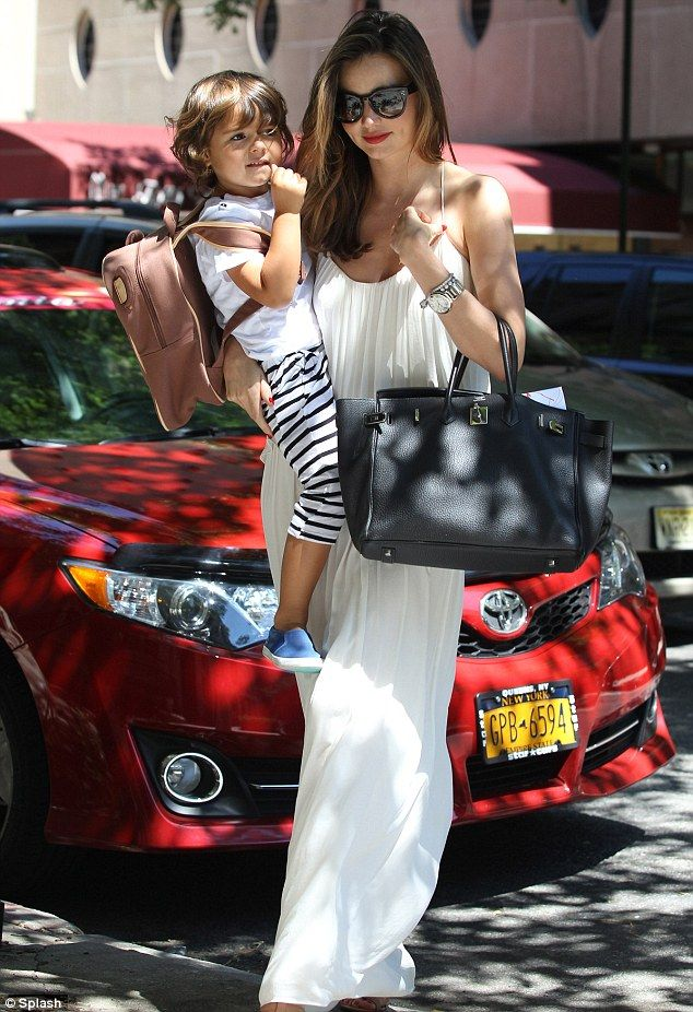Miranda Kerr looking stunning in a sleeveless pastel dress as she arrives home with adorable toddle Flynn in New York City l July 6th, 2014