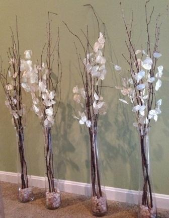 Willow Branch And Silver Dollar Branches In Tall Glass Vases With