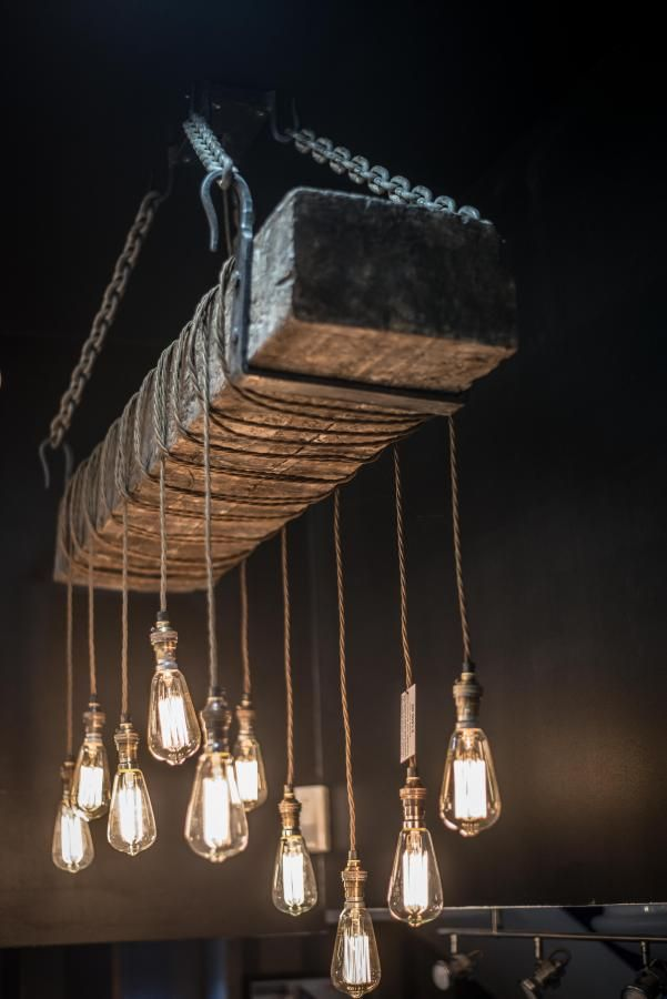 120 year old bespoke hand made railway sleep light, £1400.00 by Fraser Besant Lighting @ablectrics : This is a custom made light fitting, we can make them to order. The fitting started as a solid 120 year old British railway sleeper. It was then taken to a local stonemason who spent over 15 hours hand filing the sleeper out from behind to reduce the weight. The whole sleeper has been hollowed out like a boat. This also gave us space behind to fix the lighting junction boxes...