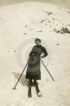 This original antique photograph is of a young girl skiing on the mountains, taken in Italy.