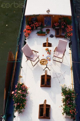 Petunias and Geraniums On Deck of Parisian Houseboat
