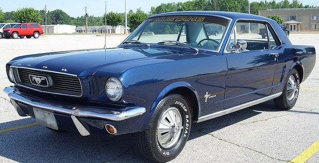 66 mustang- husband (boyfriend then) had one like this...first one off the line with white interior...wish we still had it...vintage!