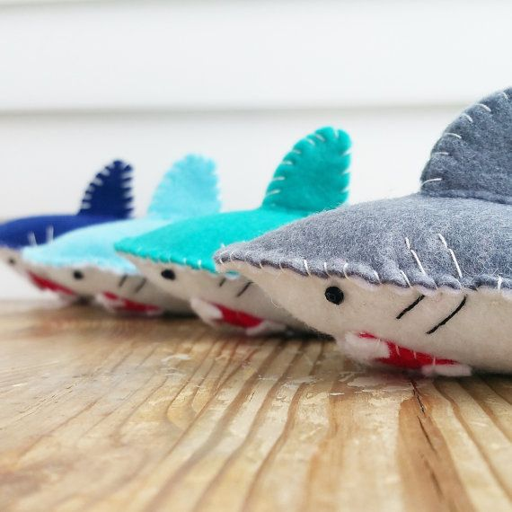JAWS V.S. CLAWS!  108 Days until shark week! Slightly early but hey, at least youll know itll arrive in time!  Our Catnip SHARKS comes in 4 colors! FOUR! Get one or all four! But just make sure its a fair fight, though Im sure your kitty has no trouble taking them all on. This SHARK makes a great unique gifts too for your fellow cat lady/man friends!   ---------------------------------------------------------------------------------------------------------  Remember to follow and tag us ...