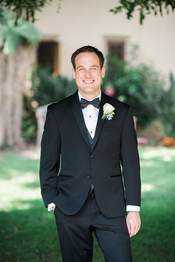 Classic groom attire for an elegant Disney Wedding at Four Seasons Hotel Silicon Valley | Annie Hall Photography | See more on My Hotel Wedding: https://www.myhotelwedding.com/blog/2016/04/11/elegant-disney-wedding-at-four-seasons-hotel-silicon-valley/