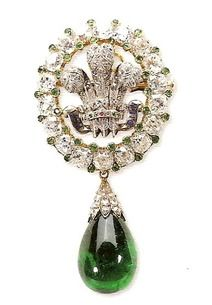 Prince of Wales Brooch, Princess Diana added the Emerald drop. Today,  the Duchess of Cornwall wears this as a brooch