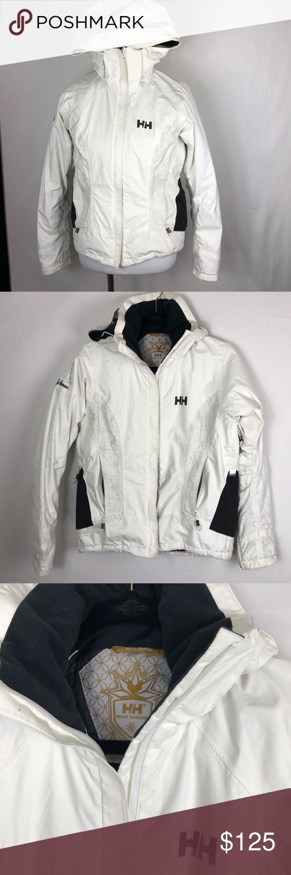 Helly Hansen white ski coat Helly Hansen white ski coat with sunburst accents and gold zipper and button details. Excellent used condition! Measurements Pit to Pit 20 inches Length 24 inches Helly Hansen Jackets & Coats