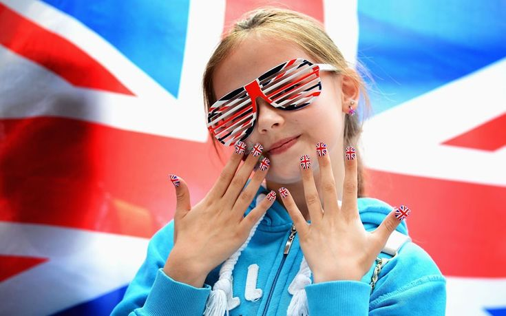 A young Team GB fan shows off her country's colours during the women's 63kg weightlifting final at ExCeL