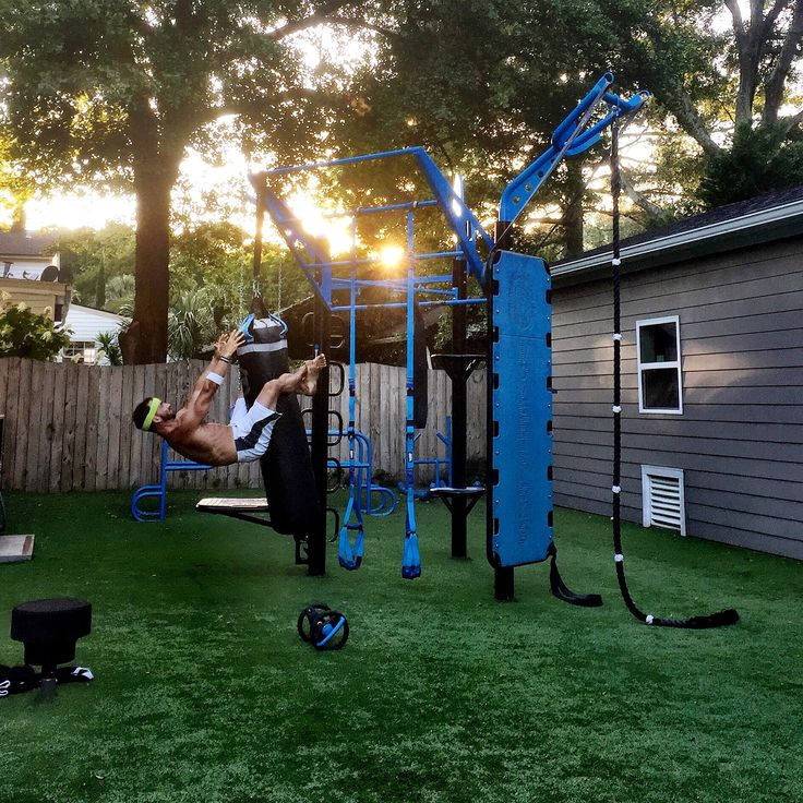 Backyard gym. Hanging sit up on heavy bag. MoveStrong T-Rex outdoor functional fitness equipment