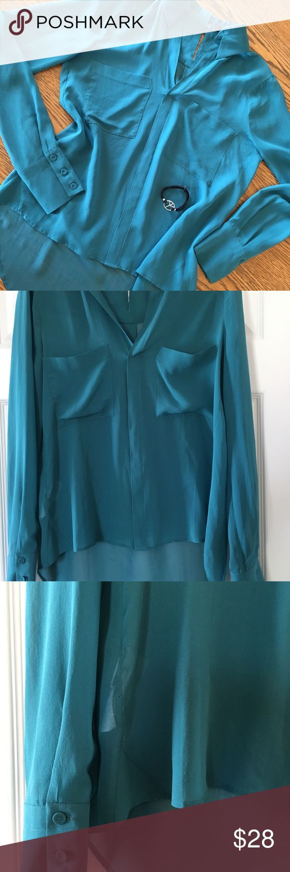 BCBG Teal Blouse XS Worn Once Emma Style Picture doesn't do justice, worn once XS Teal BCBG Maxazria Emma Style Tahiti Blue. The green shirt and gold shirt are to show more of the shirt style.  This is the tahiti blue teal color. BCBGMaxAzria Tops Blouses