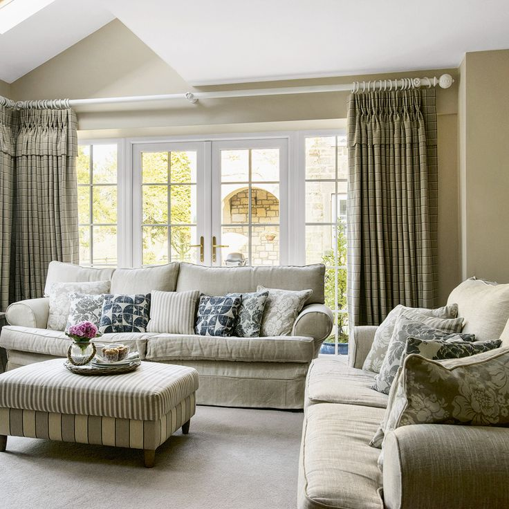 Dual-aspect living room with linen sofas and showcase curtains
