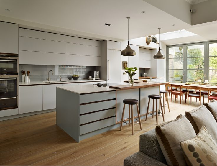 Urbo bespoke kitchen in matt lacquer, Pearl Ashes 3 by Fired Earth with island in matt lacquer Graphite 4 by Fired Earth in contemporary style by Roundhouse