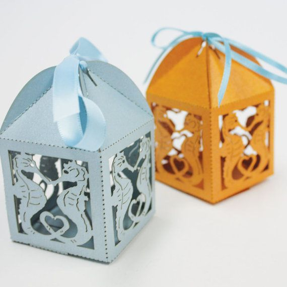 Adorable laser-cut seahorse wedding favor boxes, perfect for a beach or ocean-themed event or wedding!