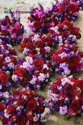 Google Image Result for http://photos.weddingbycolor-nocookie.com/p000026511-m160436-p-photo-420221/deep-red-and-purple-centerpiece-Kuga-Designs.jpg