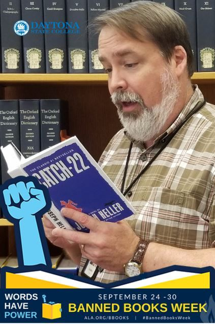 """Dustin Weeks, Librarian, Senior Professor, celebrates his right to read with Joseph Heller's """"Catch-22""""! #bannedbooksweek"""