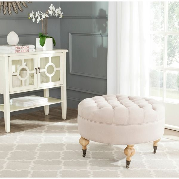 Add a little tufted lovin to your sanctuary with this off-white ottoman.
