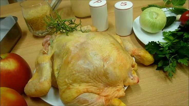 Chicken in the oven stuffed with rice and apples