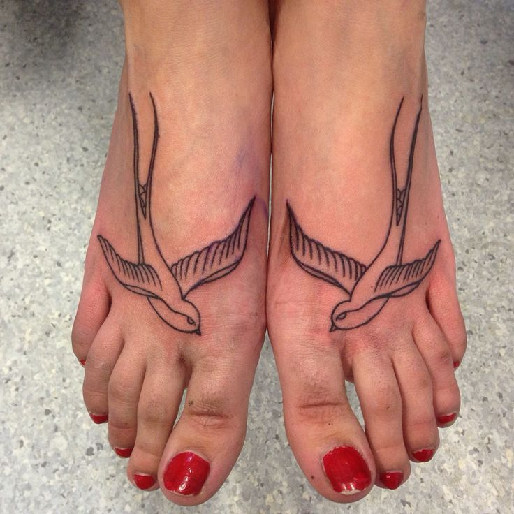 Traditional old school style swallow pair outline tattoo by Susy at Wallington Tattoo