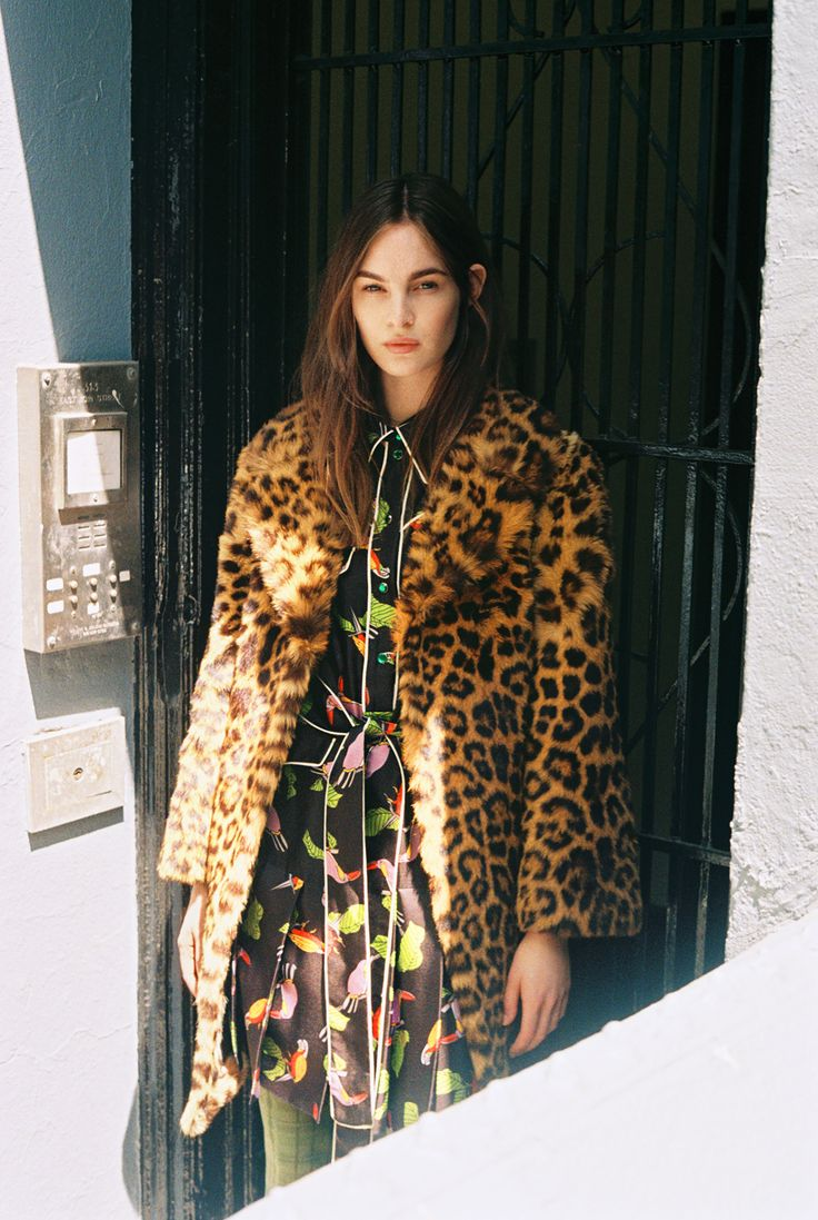 Laura Love, 24, in a vintage leopard coat, Gucci toucan print shirtdress and tights. Produced by Vogue for Gucci.