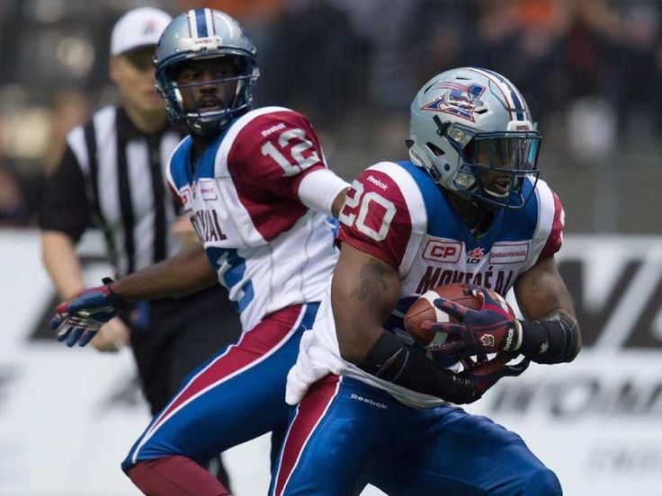 Montreal Alouettes' Tyrell Sutton (20) takes the handoff from quarterback Rakeem Cato during the first half of a CFL football game against the B.C. Lions in Vancouver, B.C., on Thursday August 20, 2015.